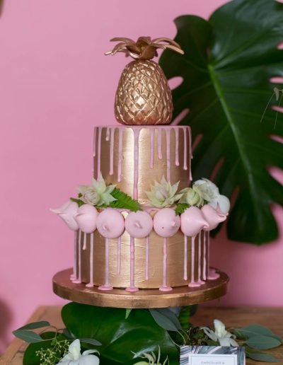 Copper pineapple and pink drip meringue wedding cake