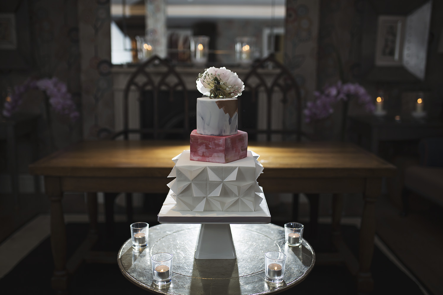 Modern geometric wafter paper wedding cake set up at The Charlotte street hotel
