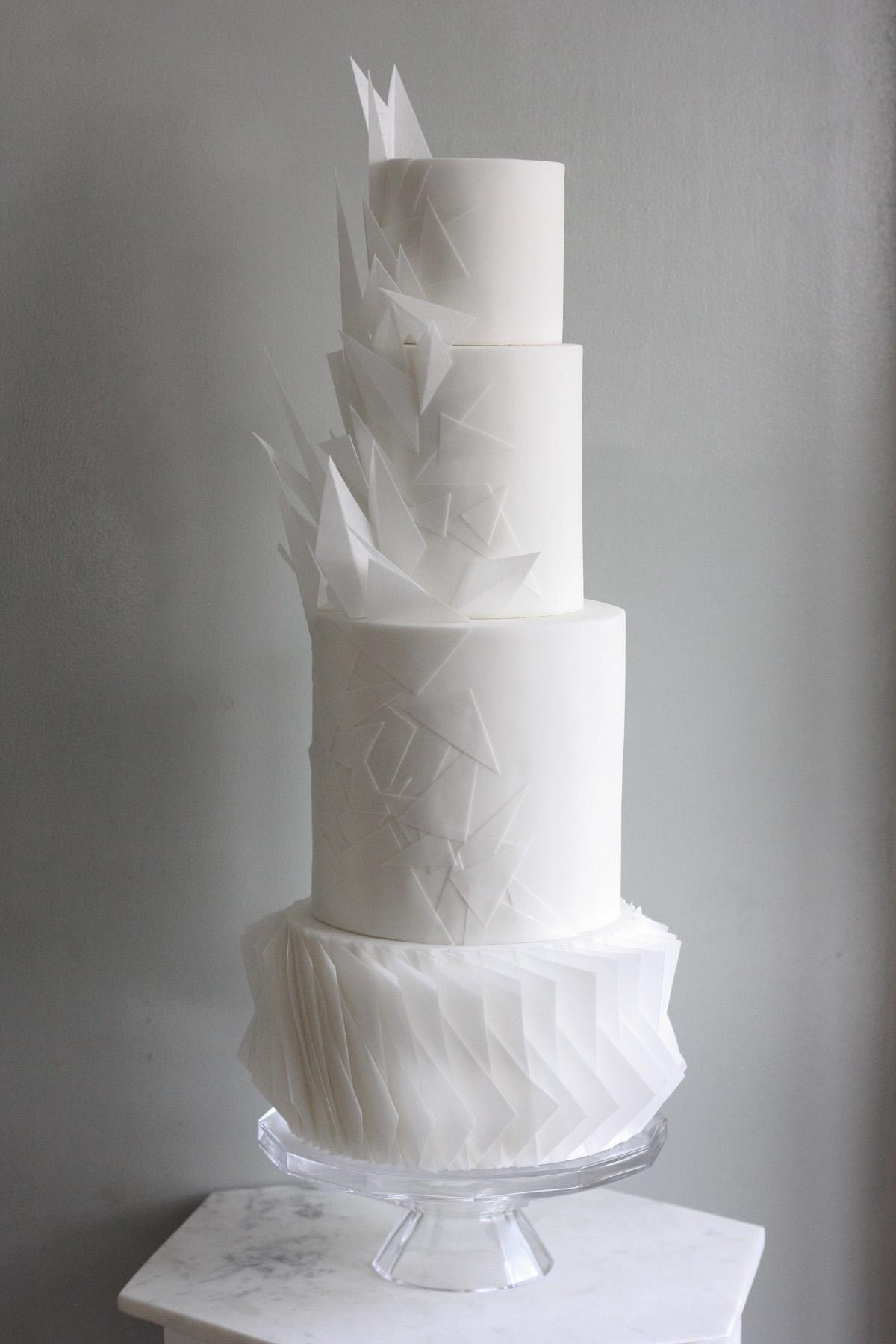 Modern four tier white origami wedding cake