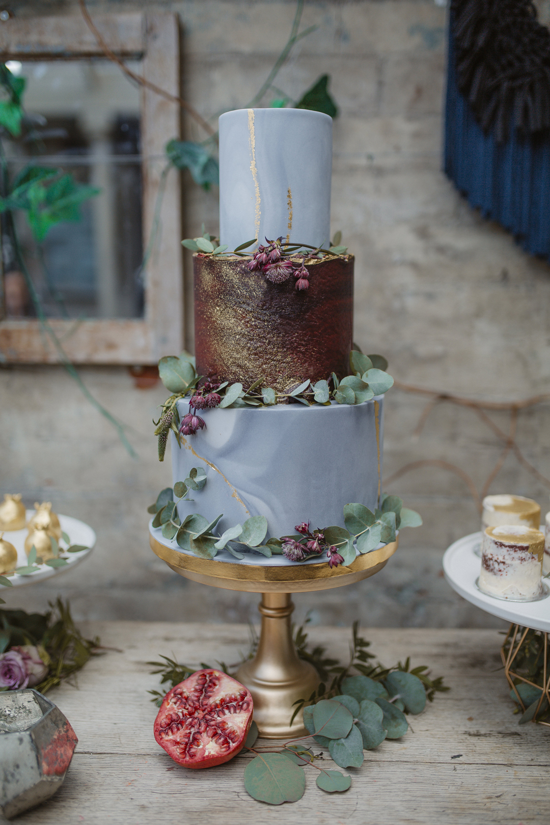 Modern boho bespoke wedding cake with marble and dark red ombre