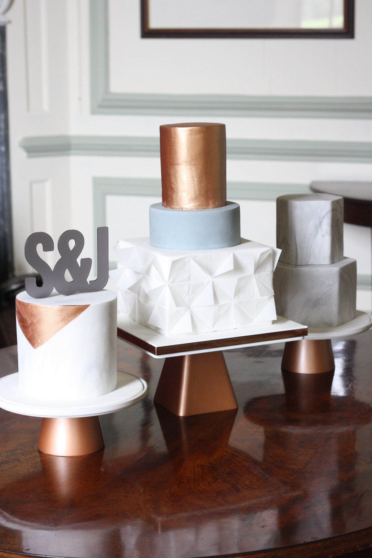 Marble Geometric And Copper Wedding Cake Trio With Copper Stands
