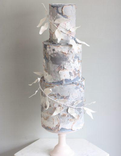 Three tier grey and white wedding cake