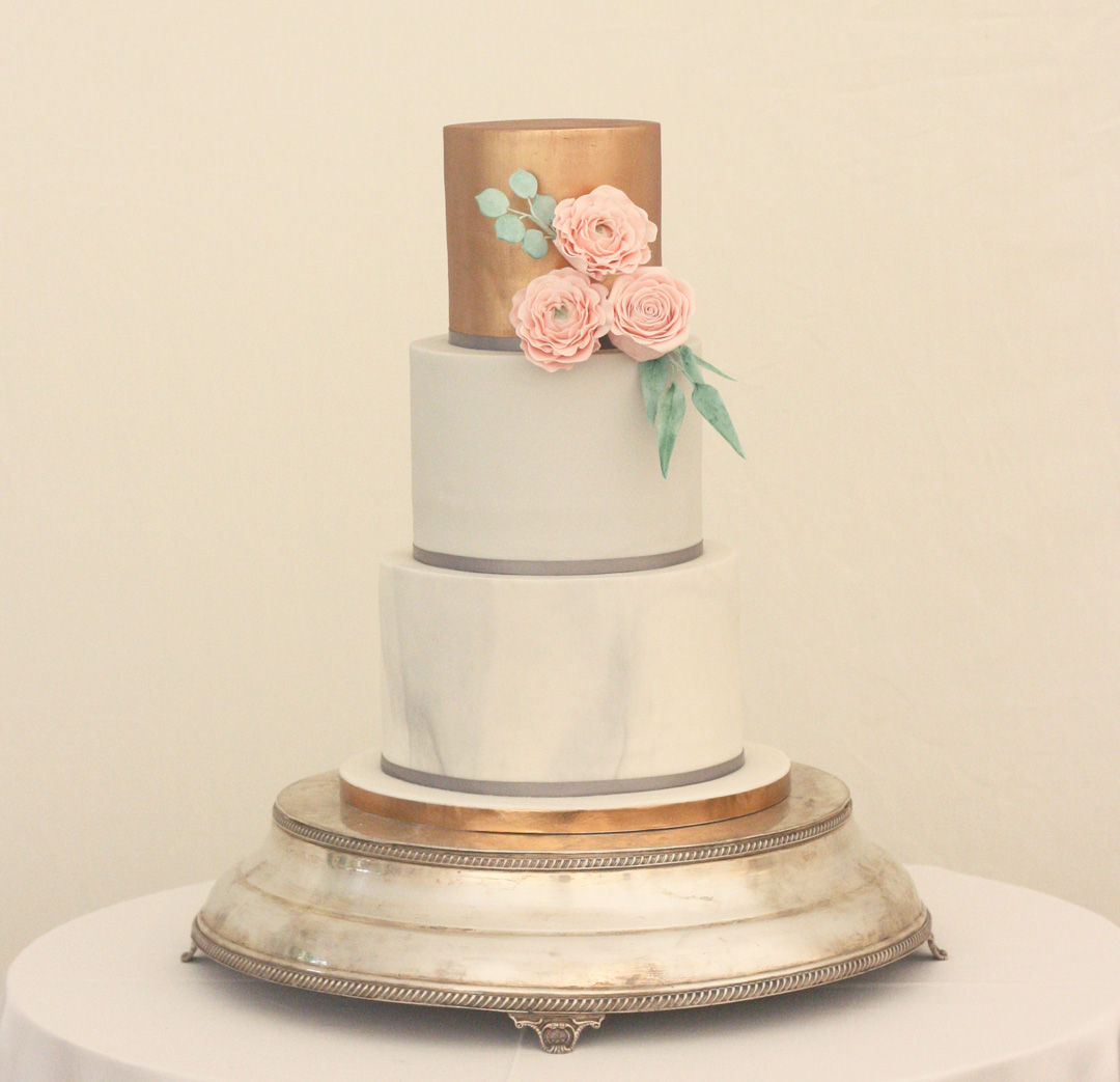 Marble, copper and grey modern wedding cake with pink sugar flowers