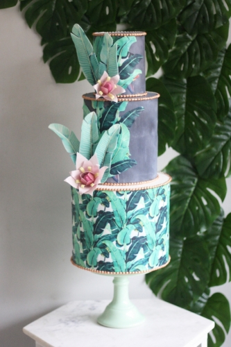 Banana leaf wallpaper cake with concrete effect, copper and banana leaves and banana flowers