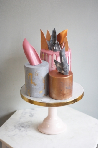 Deconstructed three tier wedding cake in pink, copper great and marble with drip