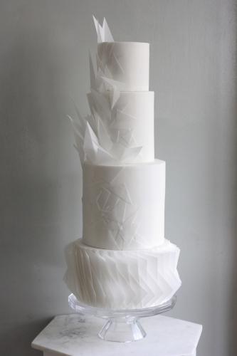 Four tier white origami wedding cake