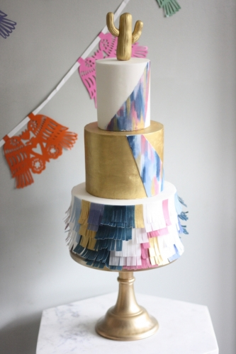 Three tier fiesta cake with piñata style tier and gold cactus