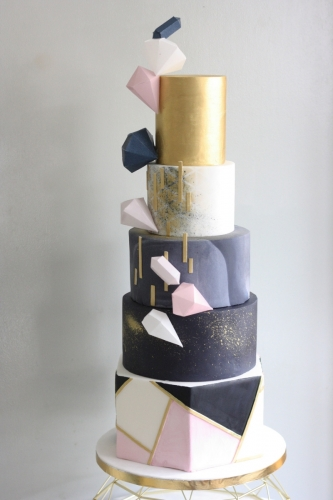 Pink navy and gold geometric wedding cake