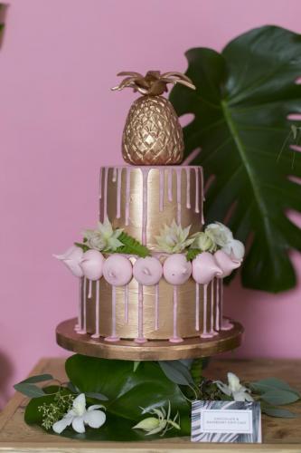 Copper pineapple and pink drip meringue wedding cake
