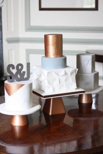Marble geometric and copper wedding cake trio