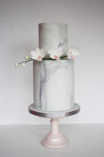 Marble pillar wedding cake with orchids