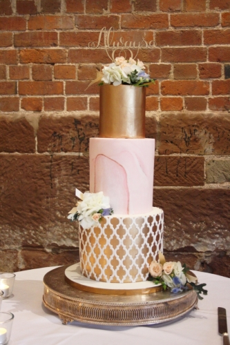 Three tier pink marble and rose gold geometric wedding cake