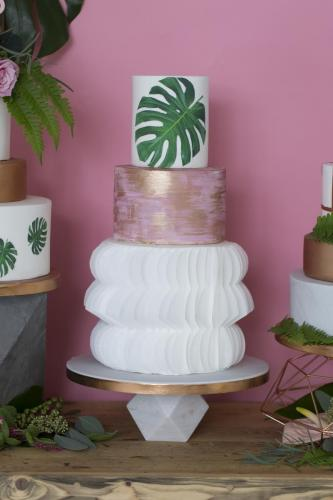 Wafer paper and tropical leaf wedding cake