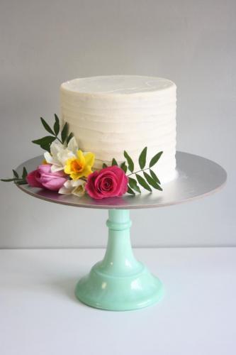buttercream and fresh flower wedding cake